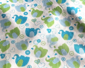 Coupon fabric green and blue elephants 50 x 70 cm