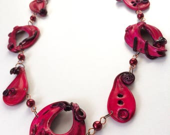 Handmade polymer clay necklace, long necklace, on copper chain, reddish color