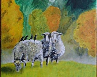 Three sheep in a meadow in a fall decor