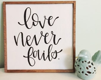 """Hand Painted """"Love Never Fails"""" Sign"""