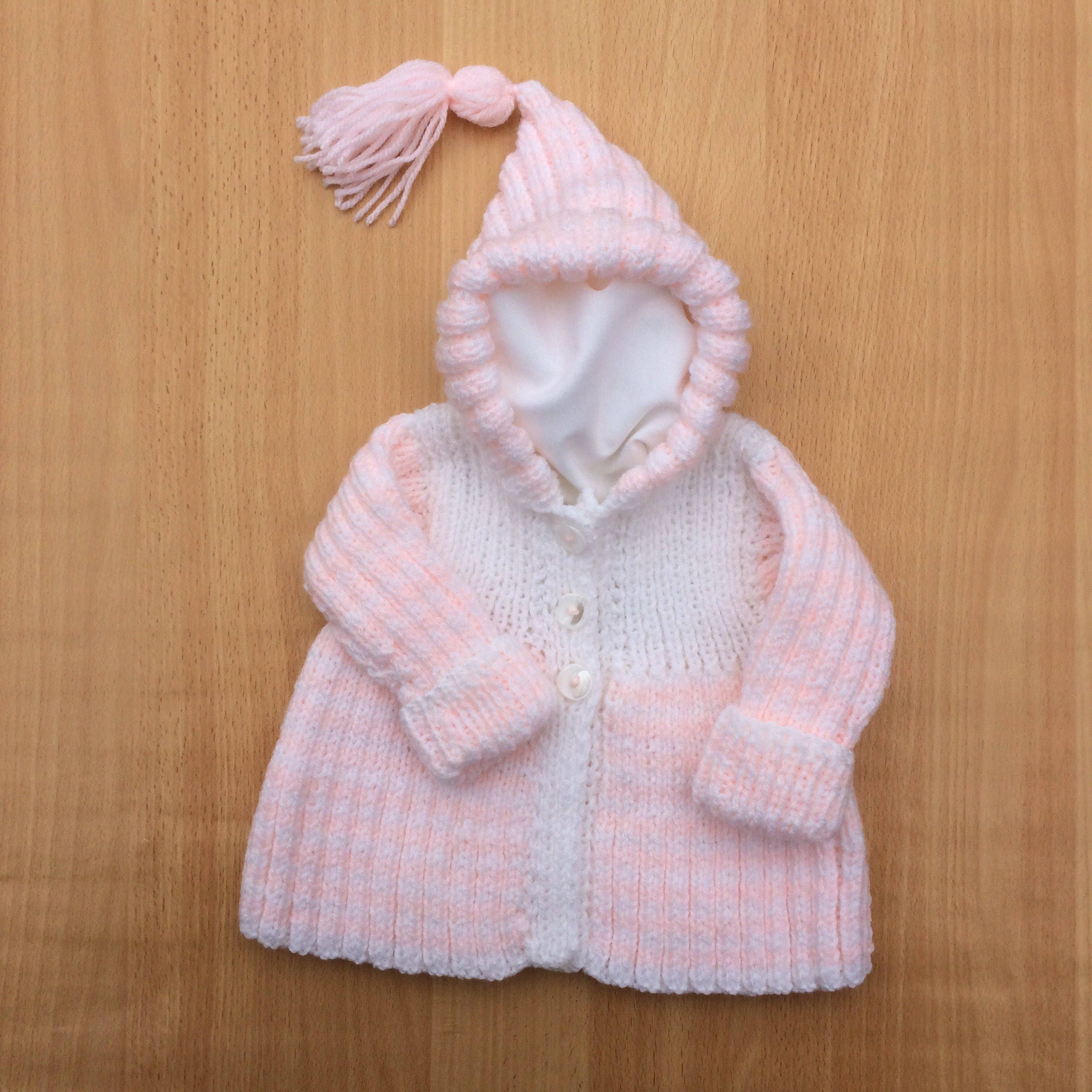 Hand knitted baby cardigan peach white coloured baby