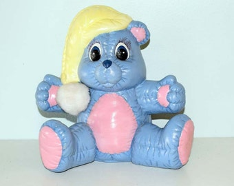 Blue, Pink and Yellow Childs Bear Ceramic Savings Bank ©1985 on the Bottom