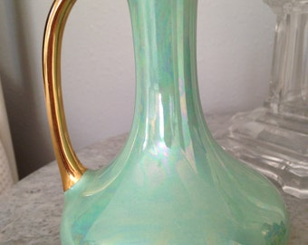 Aurora borealis glazed light turquoise pitcher/vase with 22 K gold handle