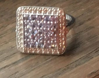 Beautiful sterling silver ring with pale purlple stones.
