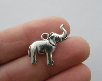 4 Elephant charms antique silver tone A1