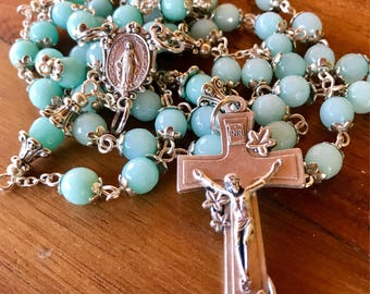 Handmade rosary in light mint green jade beads with immaculate medal center and lily of the valley crucifix