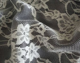 1 meter of white lace on black satin