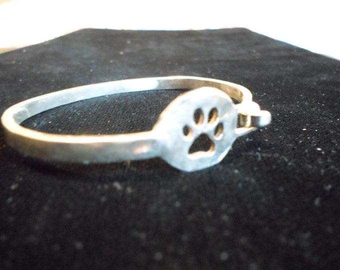 Dog paw locking bangle dime size