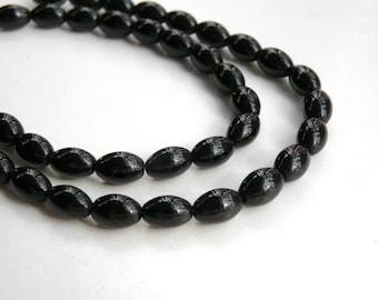 1 Glossy jet black opaque glass beads oval barrel 8x6mm full strand 5758SX