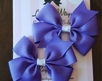 Pair of mini pinwheel bows