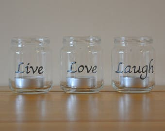 Set of 3 hand painted glass tea light holders with the words 'live', 'love' & 'laugh'
