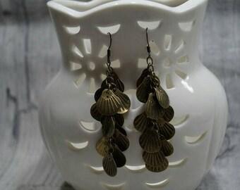 Palm seeds earrings is cut glass