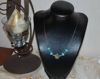 Glass turquoise glass beads necklace.
