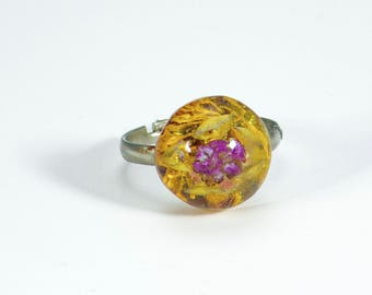 Resin sphere ring with lovely small pink flower.