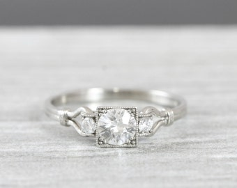 White sapphire and diamond engagement ring handmade in 14 carat gold art deco inspired
