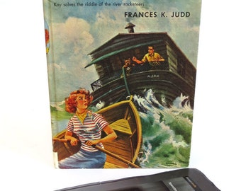 Hide your tablet in a mid-century mystery book with boats on front, blue plaid lining, Fits Kindle Fire, HD7, Fire 7, Galaxy Tab, Nook