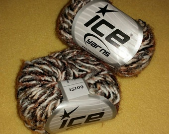 Two Skeins Eyelash Blend Yarn by Ice Yarns, novelty multi-strand yarn - black and grey boucle, off white roving, orange eyelash