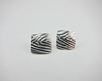 sterling silver earrings. square, textured, studs