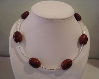 Brown necklace with silver color tube