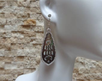Hand Carved Mother of Pearl earrings set in Sterling Silver with Pave CZ