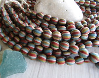 Matte striped lampwork  glass beads, round blue red yellow white ,  opaque  boho ethnic style Indonesia 8mm to 10  mm ( 8 beads ) 7ab62