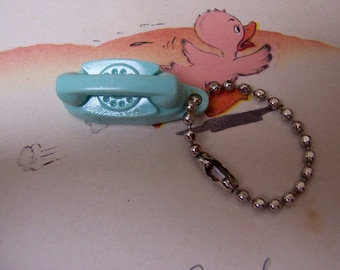 itty bitty teal telephone charm
