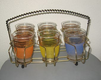 Sixties-glass basket with six old lemonade glass in various colors.