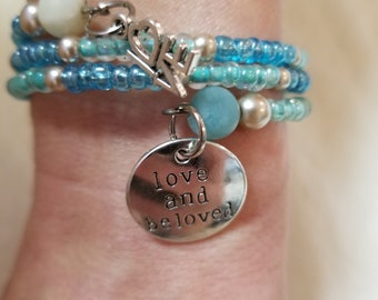 """24"""" Light Blue/Light Teal Seed Memory Bracelet with Charms"""