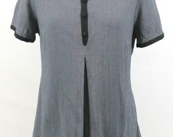 Grey cap sleeve top with black cord trim, front buttons and back tie. Sweet top, versatile top, cute top. adjustable top, summer top