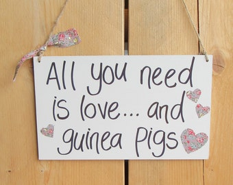 Hanging Wooden Saying Sign 'All you need is love...and guinea pigs!'