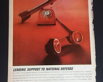 1963 General Telephone & Electronics Red Rocket Rotary Phone Print Ad