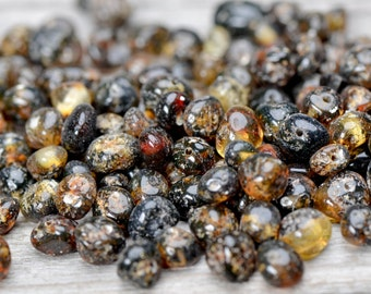 50 pcs Green Baltic amber beads with drilled hole.