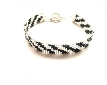 Lovely silver and black bracelet woven with miyuki beads