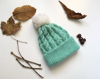 Twist hat with Pom Pom faux fur