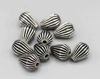 Silver Plated Copper Beads Ribbed Teardrop 14x10mm 2mm Hole 10 Beads SKU-FMB-14