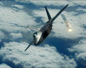 Poster, Many Sizes Available; F-22 Raptor From Kadena Air Base In Japan Releases Flare