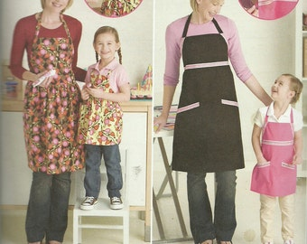 SIMPLICITY PATTERN S2555, adjustable aprons for moms, grandmas, and girls, sizes small, med, large, new and uncut