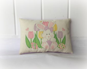 Bunny in tulips Pillow