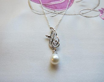 Elegant Charles Rennie Mackintosh inspired pendant in Sterling Silver with Freshwater Pearl. On Sterling Silver Chain.