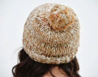 Thick wool cap with bobble, hand knitted