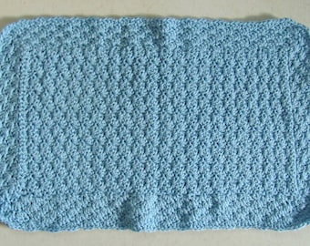 Small thick rugs, light blue 40 x 65 cm