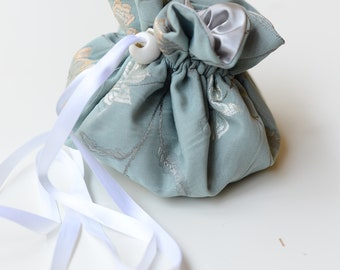 silver and pale blue drawstring pouch