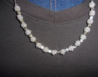 Silver chain with decorative wire beads spaced with three sided beads.