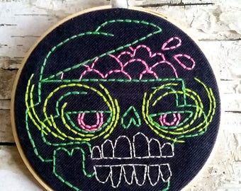 "green & pink brains skull - 5"" hand embroidered wall hanging"