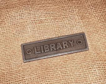 Library - Cast iron vintage plaque