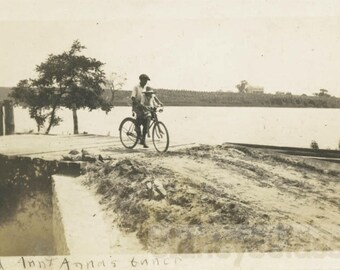 vintage photo 1916 Merle & Nancy He Rides her on His Handlebars on Bike in COuntry