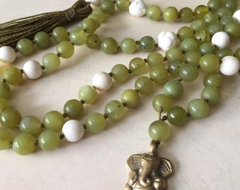 Son of Parvati mala in peridot and tridacna