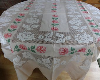 Cross stitched and needle embroidered table cloth