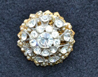 Brooch.with  Old goldtone back. Vintage rhinestone center with old seed pearls.