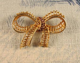1960s gold-tone open-work bow brooch, purple diamanté detail